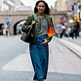 With a cool bomber and flat sandals