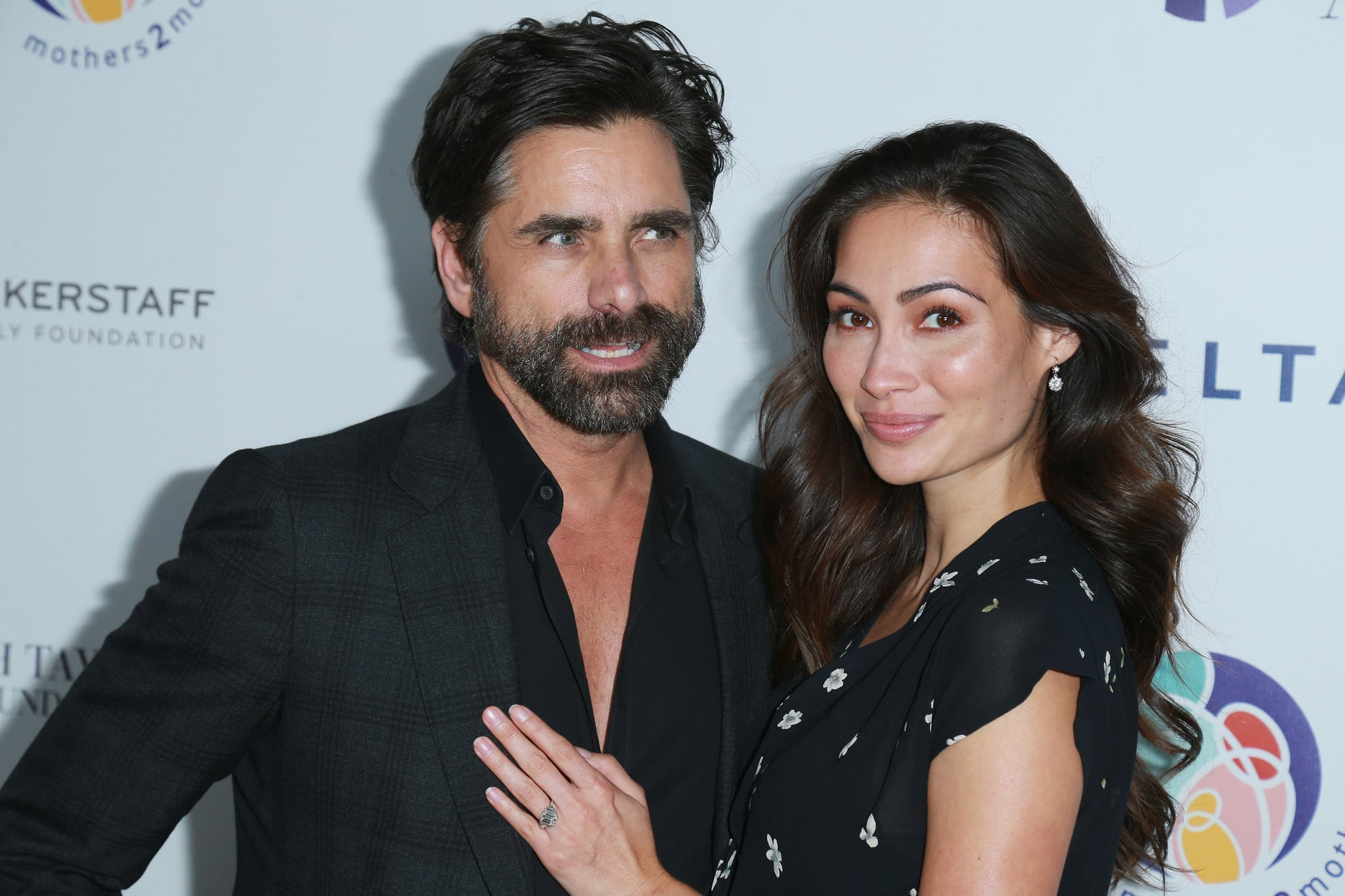 BEVERLY HILLS, CA - OCTOBER 24:  Actor John Stamos (L) and fiancee Caitlin McHugh attends the Zac Posen And Paris Jackson Host Event Supporting mothers2mothers And ETAF on October 24, 2017 in Beverly Hills, California.  (Photo by Leon Bennett/WireImage)