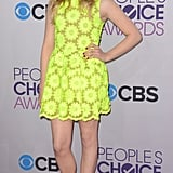 Chloë Moretz struck a retro note in a daisy-printed neon yellow Simone Rocha Spring '13 dress.