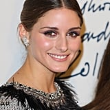 Olivia Palermo smiled at a fashion party.