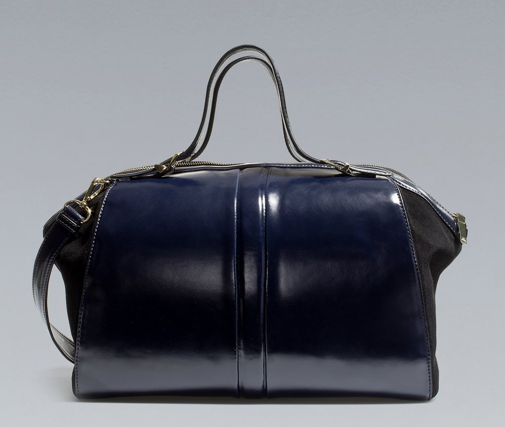 How utterly chic does this two-toned doctor bag from Zara look? It has that shiny patent leather finish, in the coolest shade of navy blue, which makes us want to add it to our It bag collection immediately.