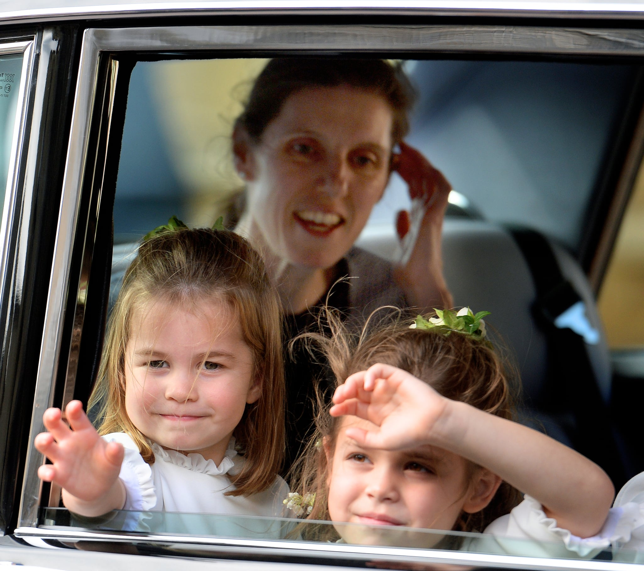 WINDSOR, UNITED KINGDOM - OCTOBER 12: (EMBARGOED FOR PUBLICATION IN UK NEWSPAPERS UNTIL 24 HOURS AFTER CREATE DATE AND TIME) Princess Charlotte of Cambridge and Theodora Williams, (accompanied by Princess Charlotte's nanny Maria Teresa Turrion Borrallo) attend the wedding of Princess Eugenie of York and Jack Brooksbank at St George's Chapel on October 12, 2018 in Windsor, England. (Photo by Pool/Max Mumby/Getty Images)