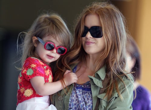 Isla Fisher carries her daughter Olive on their way to a ballet class in L.A