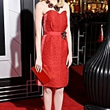 Emma hit a high note in a red woven silk and brocade sweetheart-neckline Lanvin dress at the LA premiere of Gangster Squad in January 2013, and accented the look with rich Lanvin costume jewels.