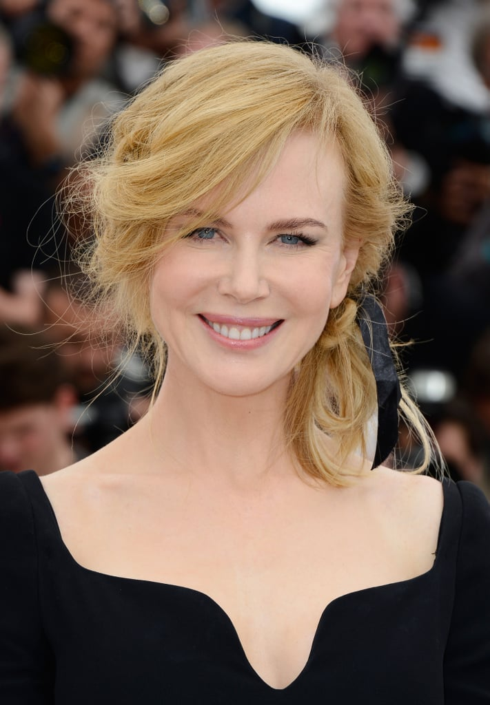 Nicole Kidman added some variety to her look for her jury photocall with neutral makeup and a sexy sideswept ponytail.