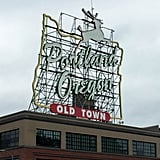 "And then there's the iconic ""Portland Oregon"" sign atop the White Stag Building. If you want to snap a photo of it (because, when in Portland...! ) it is located downtown at 70 NW Couch Street, facing the Burnside Bridge."