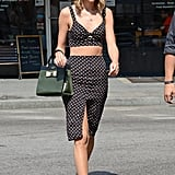 In one of her more revealing styles, Taylor's bitty bralette and slitted skirt showed off plenty of skin.