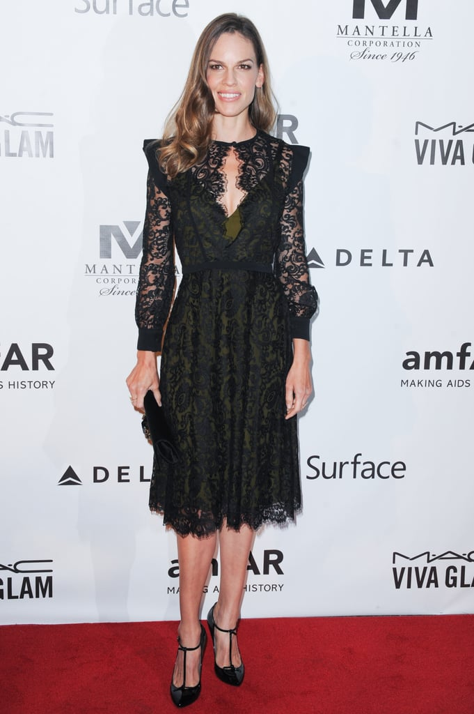 Hilary Swank attended the amfAR Inspiration gala in a ladylike black lace Gucci dress.