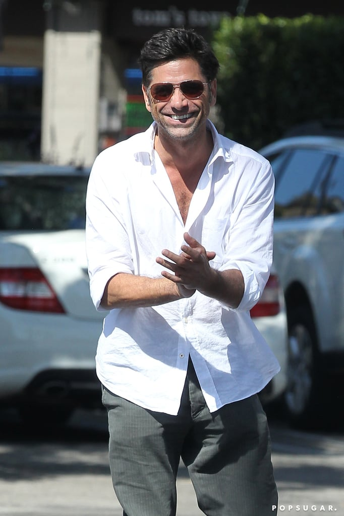 John Stamos smiled for cameras while leaving a restaurant.
