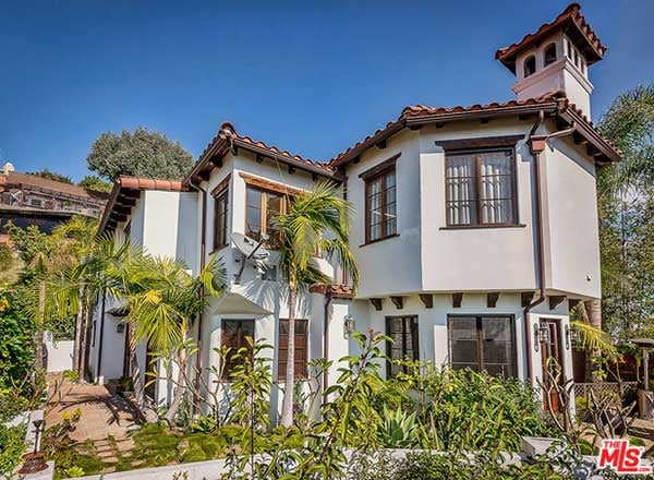 The Mediterranean style compound with a Spanish clay tile roof is