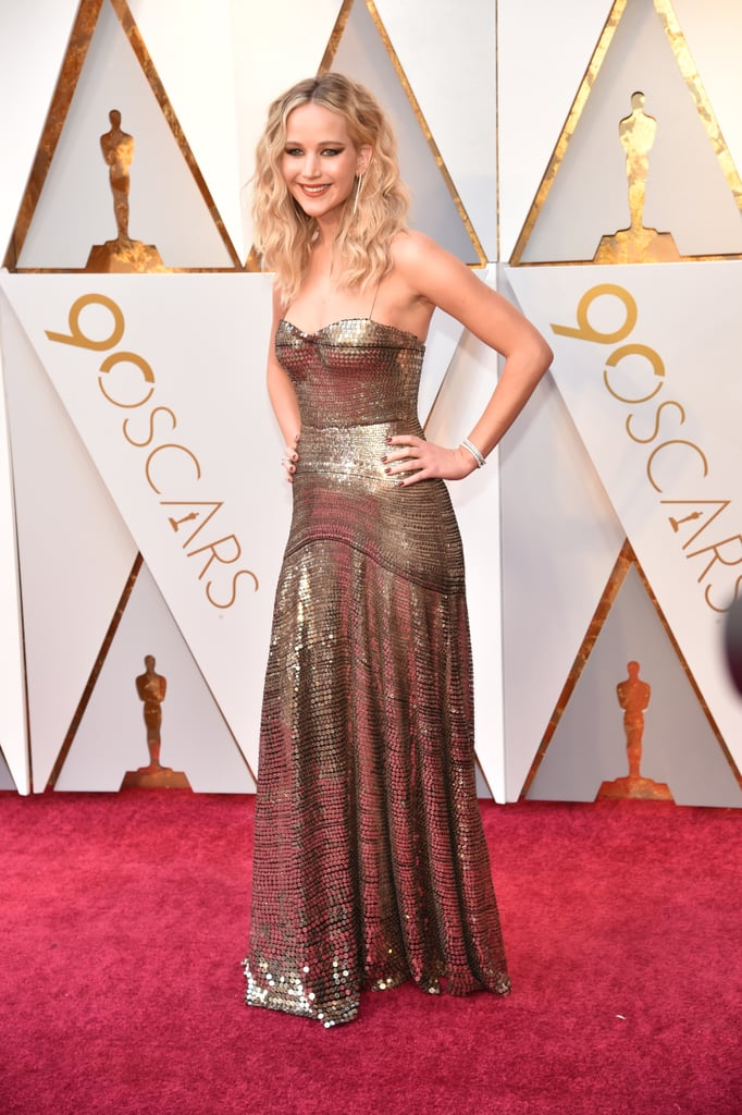 Jennifer Lawrence took a break from torturing Russian spies to attend the 90th annual Academy Awards on Sunday night. The Red Sparrow actress was dripping in gold as she made her way down the red carpet in front of photographers in a gorgeous metallic gown (note: she managed not to trip), and we could barely peel our eyes away. Keep reading to see more photos from the Oscar winner's beautiful night out below!