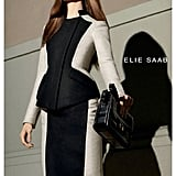 Karlie Kloss returns for Elie Saab's Fall 2012 campaign, donning a two-toned peplum suit with an elegant structured twist.