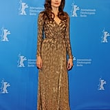 Ange opted for Jenny Packham again, chosing this golden long-sleeved embellished number for the Berlin premiere of In the Land Of Blood and Honey.