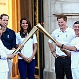 The Duke and Duchess of Cambridge, as well as Prince Harry, watched the torch pass off at Buckingham Palace the day before the London Games started.