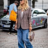 A chic plaid blazer lends baggy jeans some polish.