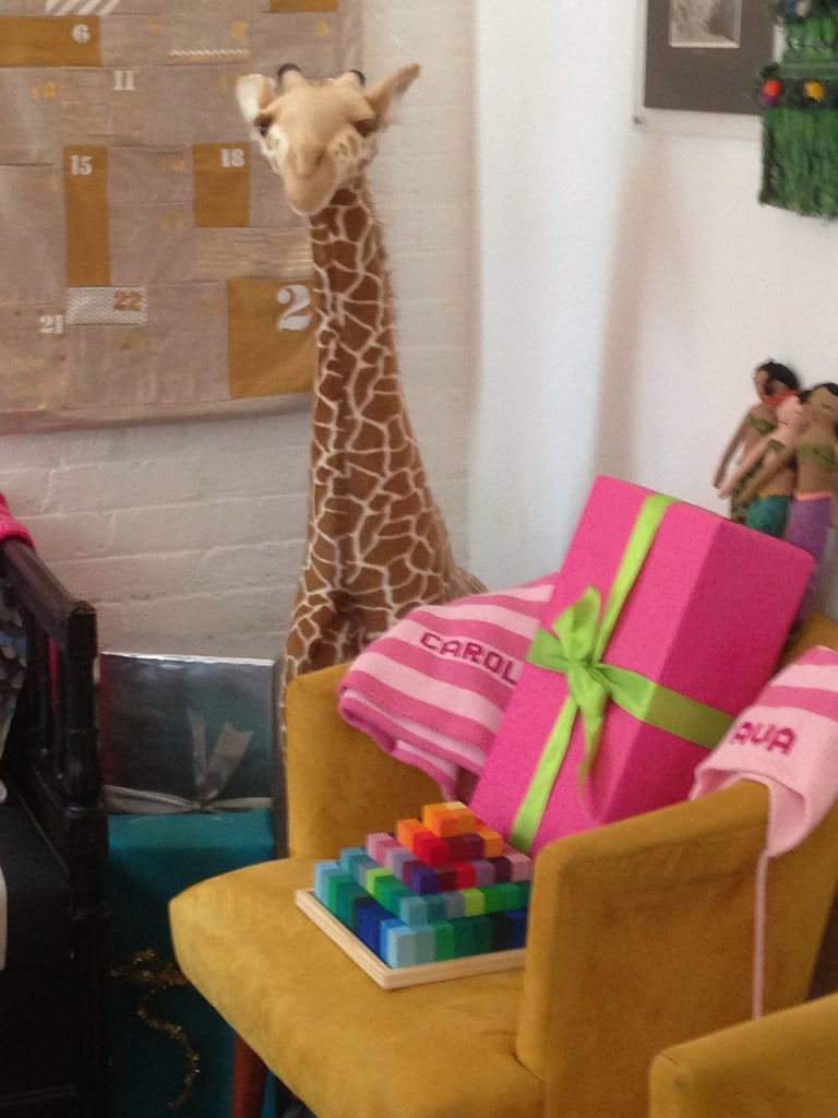 This pile full of presents is being watched over by an old favorite, the plush giraffe.