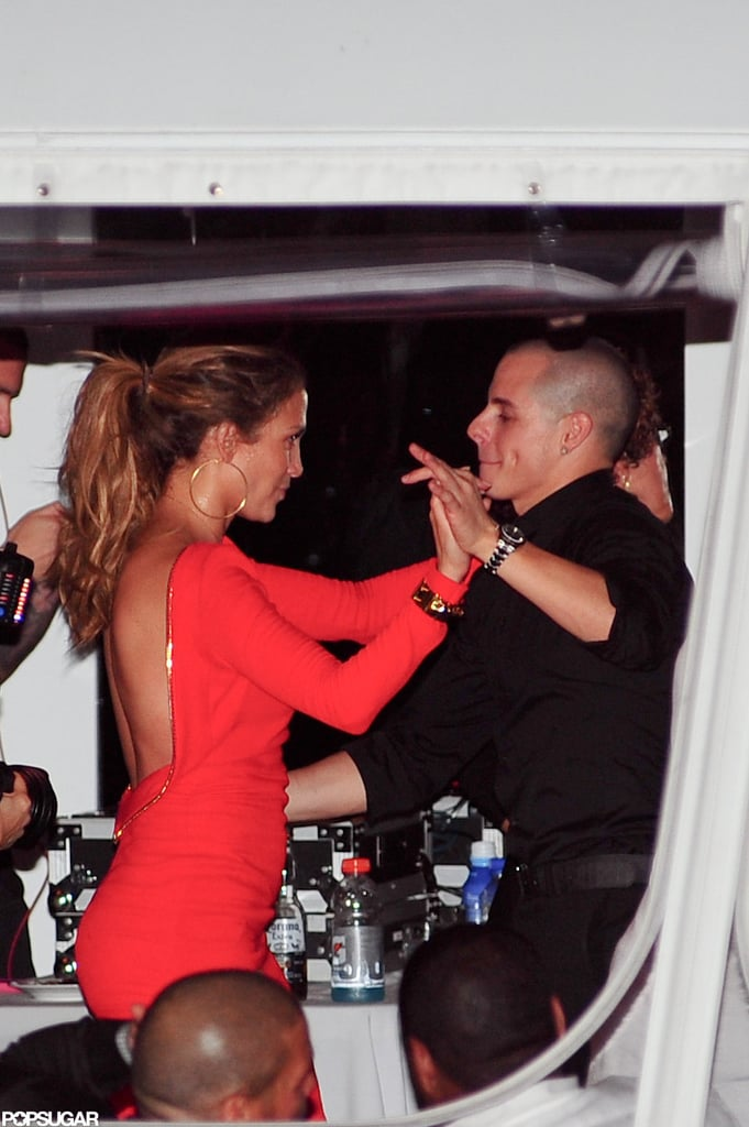Jennifer Lopez wore a hot, backless red dress for her 43rd birthday celebrations with boyfriend Casper Smart in NYC.