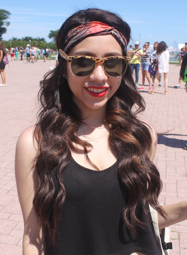 This music-lover paired her perfectly coiled waves with a bright red lip hue and a coordinating headband for a music-fest-chic style.
