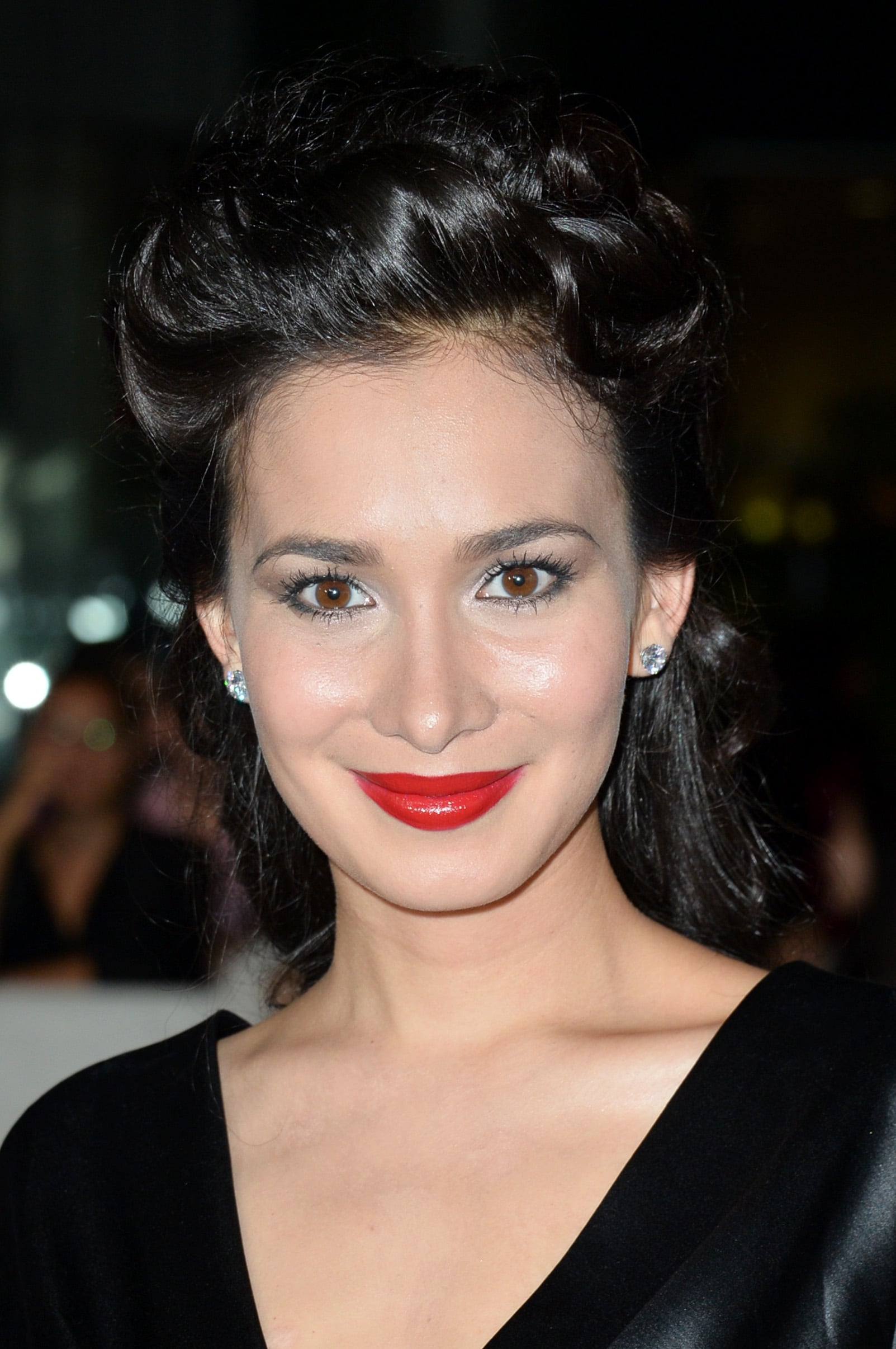 At the premiere of American Dreams, Celina Jade's red lip popped against her all-black attire.