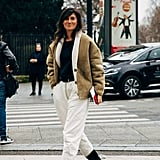 Style Your White Pants Over Your Knee-High Boots