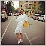 Anne V. headed to set in a cozy white robe and her bright yellow Louis Vuitton bag. Source: Instagram user annev_official