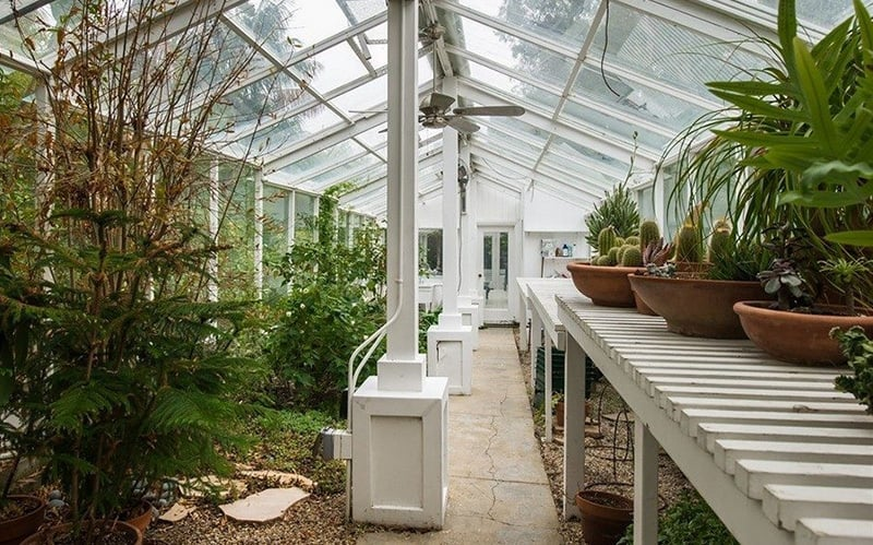 One of the property's two greenhouses is designated exclusively for organic produce.