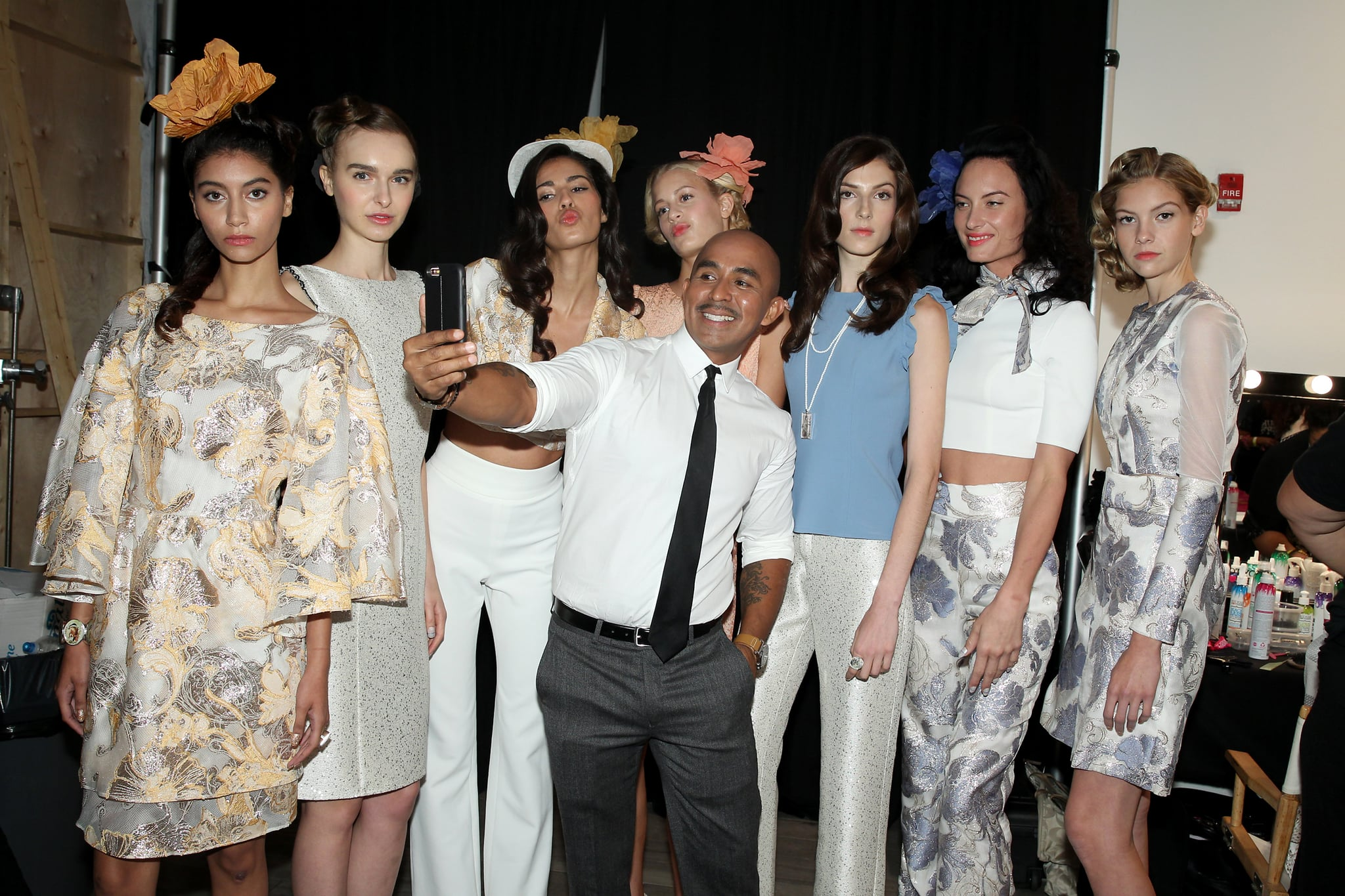 NEW YORK, NY - SEPTEMBER 13:  Raul Penaranda poses backstage with models at Kia STYLE360 Hosts Raul Penaranda Spring 2017 Momentum Fashion Show on September 13, 2016 in New York City.  (Photo by Thomas Concordia/WireImage Style360)