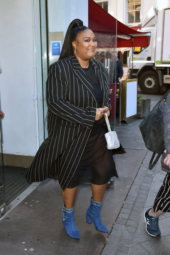 Lizzo makes even the simplest outfit look chic in these adorable denim boots and an oversized pinstripe coat. The only way to accessorise? With a glimmery silver purse, of course.