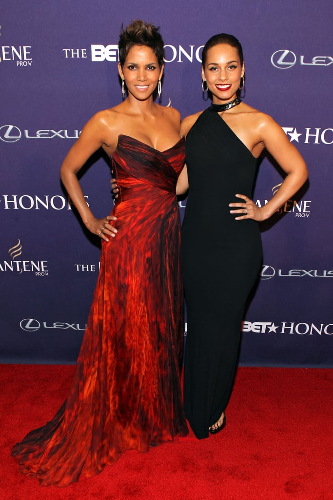LA wasn't the only city with award-show action taking place last night, since Washington DC welcomed the 2013 BET Honors. Gabrielle Union hosted the event, which will air on BET Feb. 11, and walked the carpet in a sexy green gown. Halle Berry, who was honored with an award for service, chose a strapless Monique Lhuillier dress for the occasion and posed alongside pal Alicia Keys on her way inside. Alicia looked glamorous in a black CD Greene ensemble, though she changed into a fitted red number to perform during the show. Brandy also took the stage and sang with Anthony Burrell, while Kelly Rowland mingled with pals backstage and in the audience.