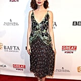 Lily Collins stepped out for BAFTAs in a Dior dress and Schutz heels.
