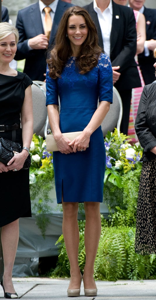 Another shot of Kate Middleton in her lacy blue Erdem dress, nude pumps, and a long nude clutch.