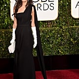 Amal Clooney channeled Old Hollywood glamour in a sleek Dior gown and white gloves in 2015.