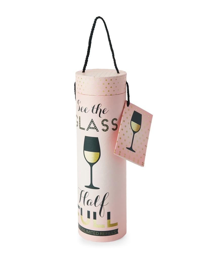 tri coastal Glass Half Full Wine Bottle Holder ($6)