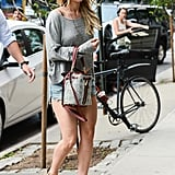 Jennifer Lawrence's take on cutoffs is something we like to call the everyday bohemian. She relies on breezy silhouettes and hippie-inspired accents, but the overall feel is still totally accessible, not overthought.