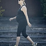 Reese Witherspoon went for a bump-baring walk.