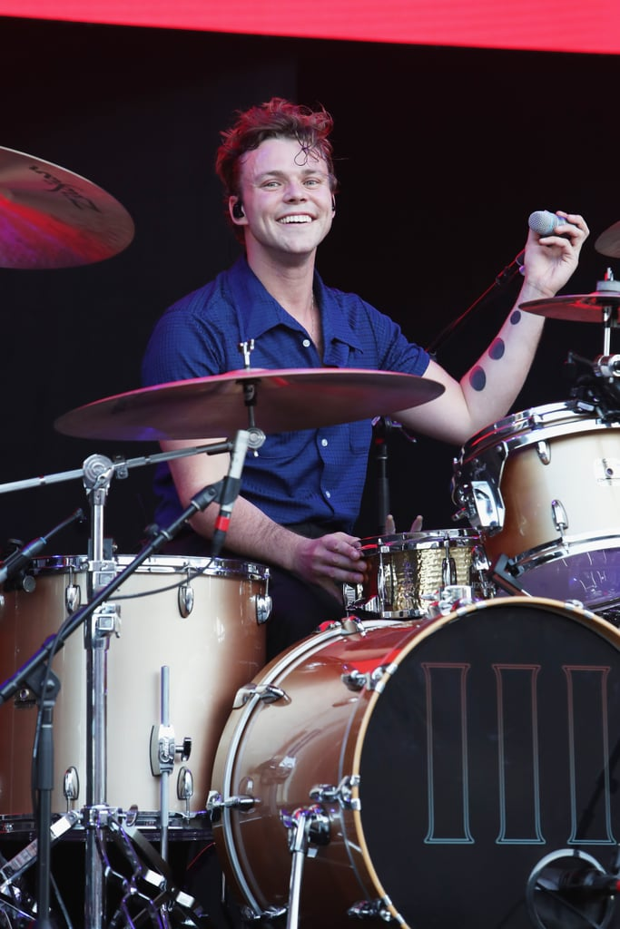 "On top of being talented musicians, the men of 5 Seconds of Summer are also very attractive. Case in point, their drummer Ashton Irwin. While the 25-year-old really knows how to get fans going crazy when he's on stage, he also knows how to get our hearts beating a little faster with his hot appearances. Whether he's sporting slicked back pink hair or showing off his curly locks, he always manages to make us swoon. Seriously, his sweet smile could melt even the coldest of hearts. Don't believe us? Take a look at some of his hottest moments over the years.       Related:                                                                                                                                5 Seconds of Summer Go on a Crazy Trip For Their Edgy ""Teeth"" Music Video"
