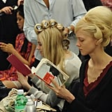 A model read James Clavell's Shogun backstage at the Douglas Hannant show during Spring 2013 Mercedes-Benz Fashion Week.