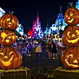 Smiling jack-o'-lanterns greet guests.