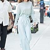 Gigi aced monochromatic dressing in a pale blue Sally LaPointe ensemble.