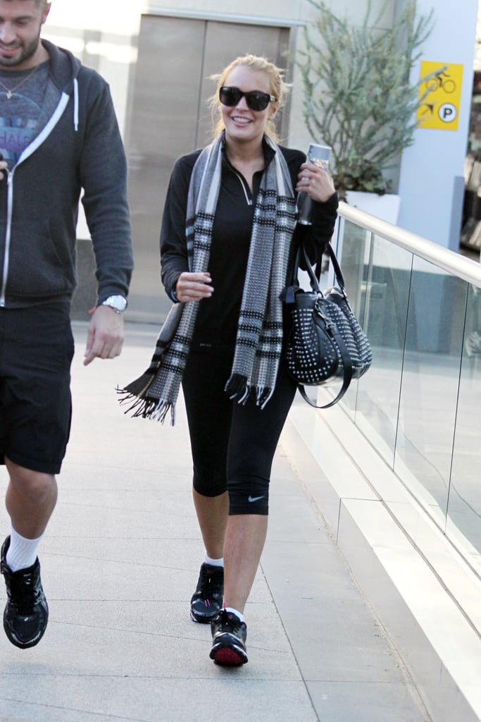 Lindsay Lohan had a big smile on her face as she kicked off her new year with a workout in Hollywood. She left rehab and moved to a beach house in Venice after leaving the facility. The property is next door to her ex-girlfriend Samantha Ronson's place — though Lindsay says she had no idea that she was moving in adjacent to her ex and says she'll move to keep the peace if necessary.