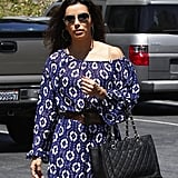 Eva Longoria added a cool touch to her feminine printed dress via sporty aviator sunglasses in LA. Get these Ray-Ban wrap aviator sunglasses ($145) to do the same.