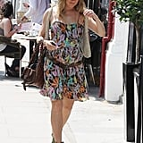 Sienna Miller looked ready for Spring in a colorful dress in London.