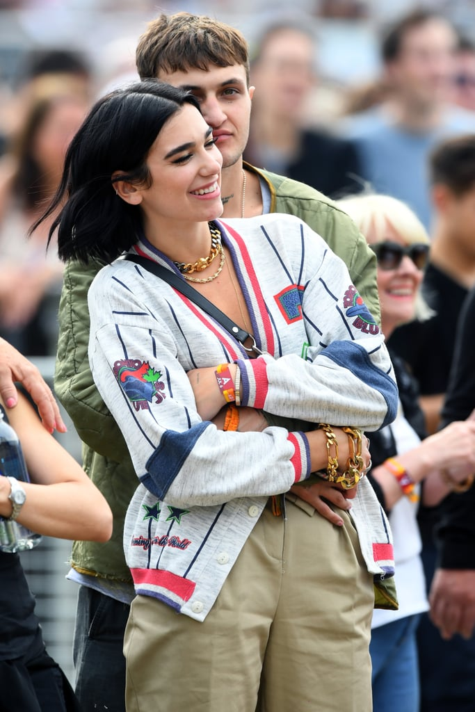 """It looks like Dua Lipa has moved on from her ex-boyfriend, 31-year-old celebrity chef and model Isaac Carew. The 23-year-old """"New Rules"""" singer was snapped in the arms of Gigi and Bella Hadid's younger brother, Anwar, 20, while attending the British Summer Time Hyde Park music festival in London on Saturday. Anwar was spotted with his arms wrapped around Dua as she flashed a huge smile. At one point, they even shared a sweet kiss.  While Dua split from Isaac Carew in May, Anwar was most recently linked to one of Gigi's close friends, Kendall Jenner. Though the two were spotted kissing after the 2018 CFDA Awards, they later shut down relationship rumors. Judging by Dua and Anwar's adorable snaps, it looks like love is most definitely in the air. Take a look back at their PDA-filled outing ahead."""