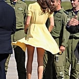 While arriving in Canada in July 2011, Kate's yellow Jenny Packham dressed got swept in the wind in front of cameras (and soldiers).