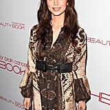 Eliza Dushku made her way down the gray carpet in a neutral ensemble.