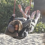 Jennifer Lopez and Casper Smart hugged while on a swing.