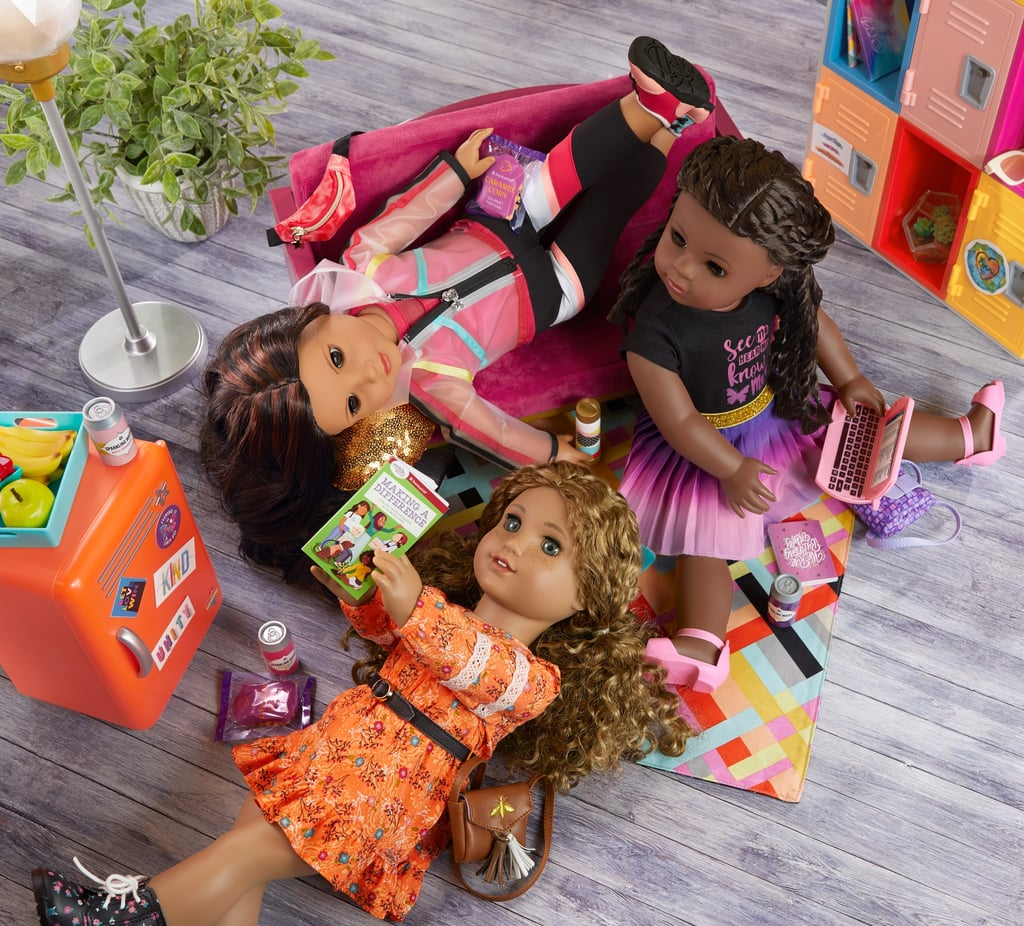 """Every American Girl doll has a story, and the brand's three newest faces are using theirs to spread messages of equality and unity to children all across the country. In honor of its 35th anniversary on Sept. 23, American Girl released a diverse new World by Us collection of dolls whose stories and designs better reflect the lives of children in 2021. The new cast of characters includes Makena Williams, Evette Peters, and Maritza Ochoa, whose stories reflect a passion for important social causes, including racial equality, environmentalism, and immigration. """"We hope our fans learn that they're never too young to contribute to the larger conversation and help make the world a more inclusive, unified place."""" """"We created the new World by Us line to accelerate our progress in diversifying our characters and stories to better reflect what it means to be an American girl today,"""" said an American Girl spokesperson. """"Through Makena, Evette, and Maritza, as well as future characters to come, we hope our fans learn that they're never too young to contribute to the larger conversation and help make the world a more inclusive, unified place.""""  Created in collaboration with Katrina Lashley, Yasmine Mabene, M. Lucero Ortiz, Dr. Deborah Rivas-Drake, Deanna Singh, and teen activist Naomi Wadler, the collection promotes representation and inclusivity. By emphasizing the importance of inclusion, fairness, and respect, World by Us hopes to act as a model for children to celebrate themselves and others. In addition to the new line, American Girl also hosted a fashion show — in partnership with Harlem's Fashion Row, an agency providing media and marketing opportunities for designers of color — at American Girl Place in New York on Sept. 23. Along with a $25,000 donation to nonprofit ICON360, the event, hosted by Prabal Gurung, helped raise awareness for the next generation of BIPOC leaders in fashion.  Each American Girl doll in the World by Us collection comes with a signature outfit a"""