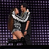 Beyoncé cuddled her man as they hit the stage for the Global Citizen Festival: Mandela 100 in December 2018.