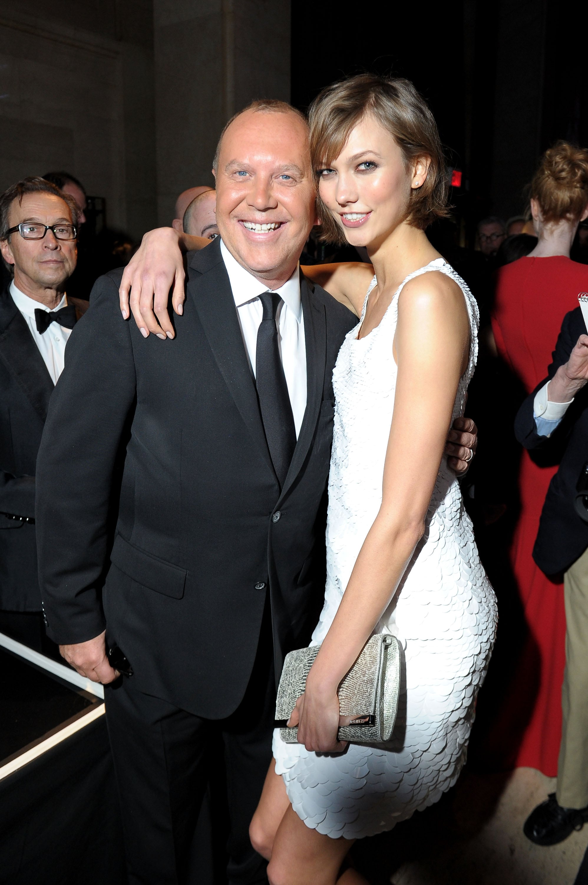 Karlie Kloss got chummy with Michael Kors at the amfAR New York Gala in February 2013.