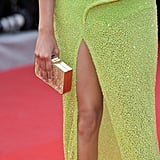 Another shot of Freida's thigh-high slit and boxy clutch.